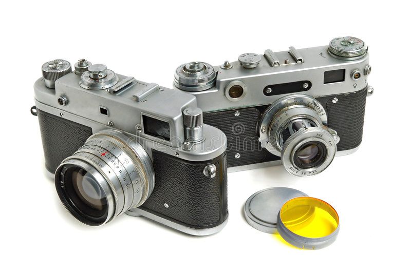 Vintage cameras. With photofiltes on white background stock photo