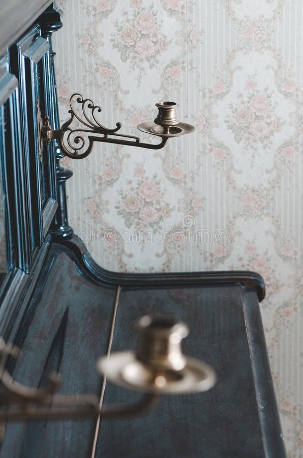 Vintage candelabrum on  piano. Vintage candelabrum on the piano stock photo