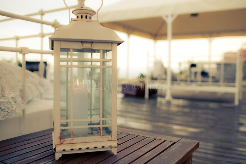 Vintage candle holder in white. Outdoor candle holder in white royalty free stock photography