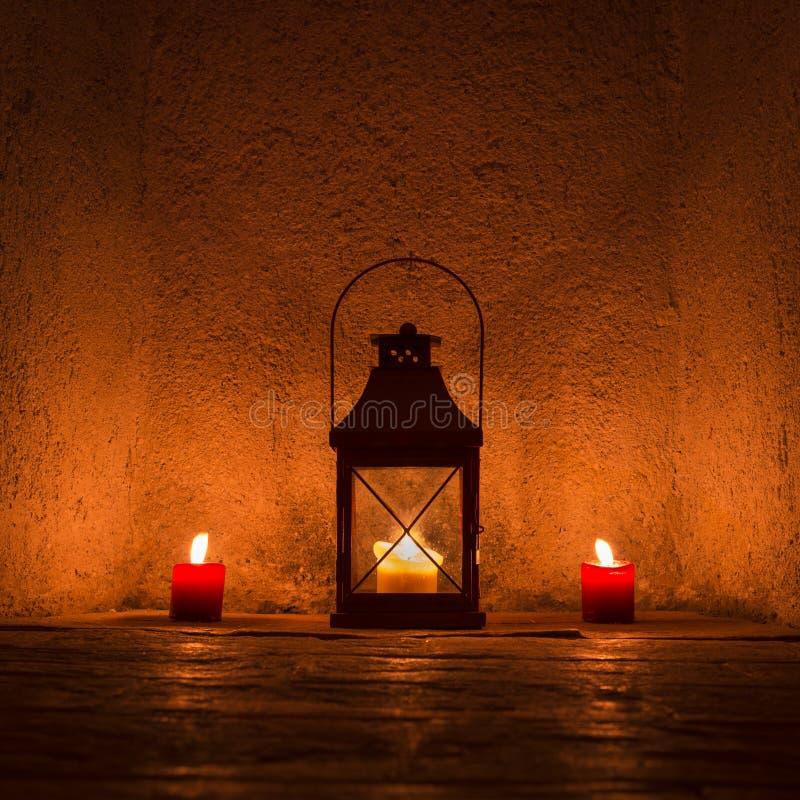 Vintage candlelit in metal lantern stock images