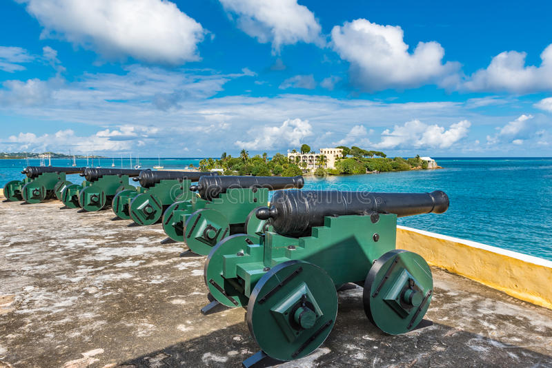 Vintage cannons facing the Caribbean ocean defending the bay stock image