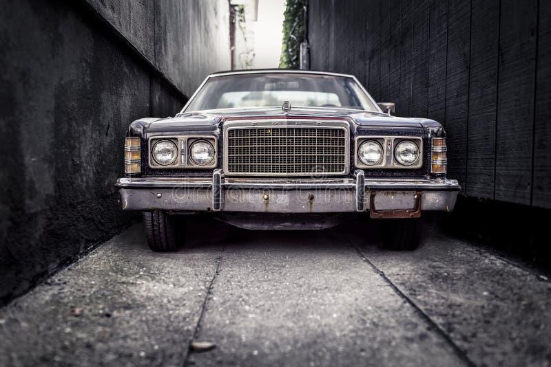 Vintage car in alleyway stock photo
