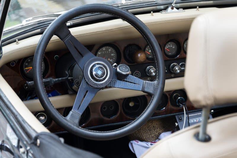 Vintage car Clenet oldsmobile veteran roadster. SAALBACH-HINTERGLEMM, AUSTRIA - JUNE 21 2018: Vintage car Clenet oldsmobile veteran roadster produced in 1970s royalty free stock images