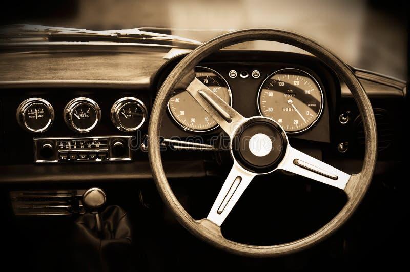Vintage car dashboard. Sepia toning stock photos