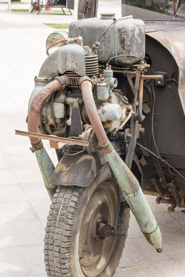 Vintage car engine on the front wheel royalty free stock image