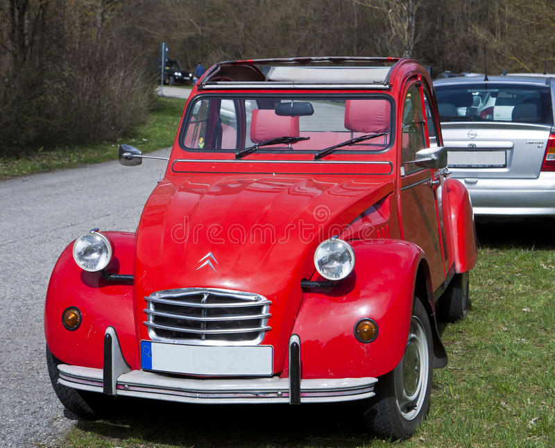 Vintage car, French Citroen 2CV red. Vintage bright red Citroen 2 CV parked on street royalty free stock images