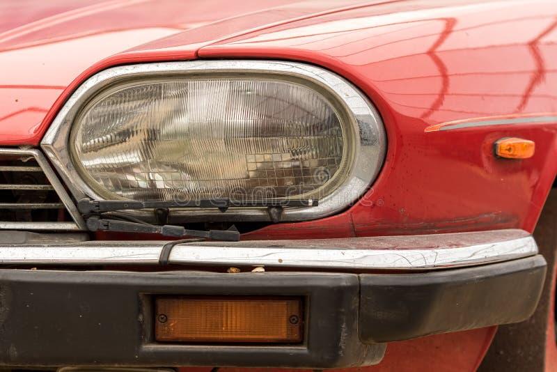 Vintage car headlight. Retro headlamp with wiper on classic vehicle. stock photos