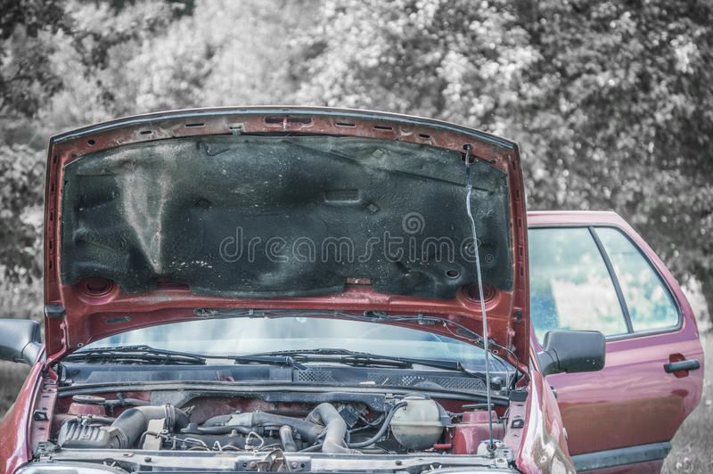 Broken car engine. Photo shoot of vintage car that needs to be repaired. Great and creative photo shoot that can be used in commercials, internet pages and other stock image
