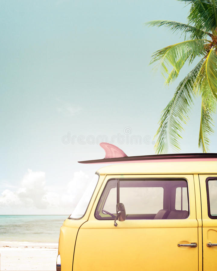 Vintage car parked on the tropical beach. Seaside with a surfboard on the roof royalty free stock image