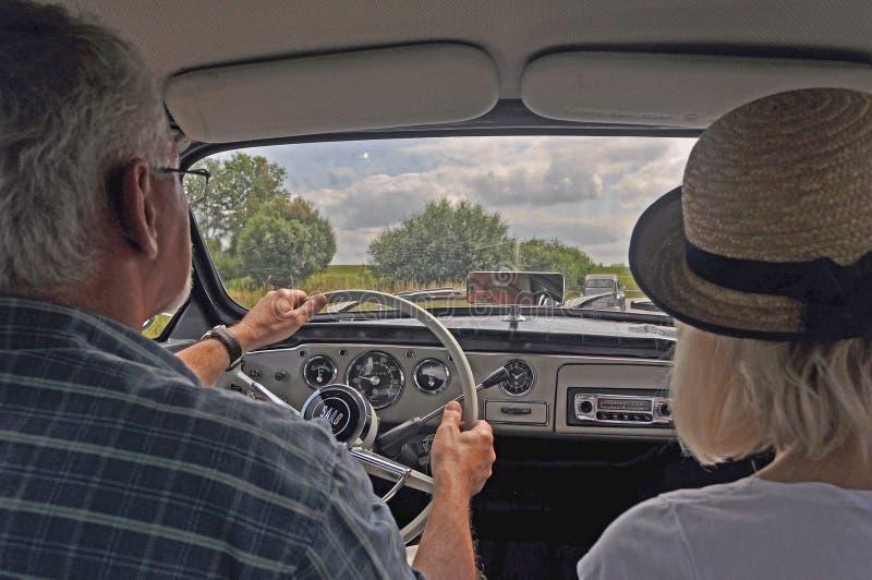 Vintage car Saab 95 driving stock photos