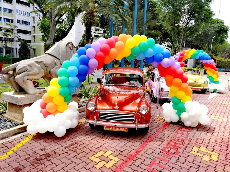 Vintage cars and colourful balloons royalty free stock photo