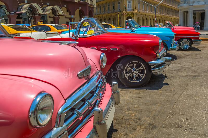 Vintage cars at Parque Central in Havana royalty free stock photos