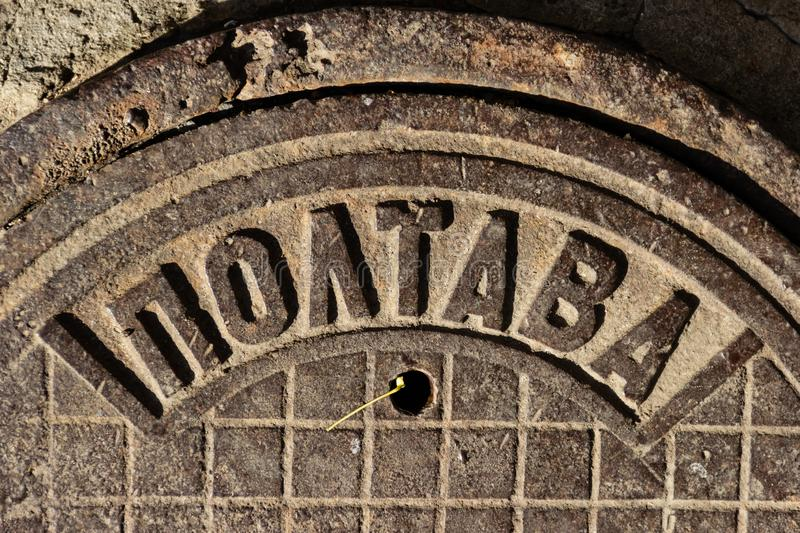 Vintage cast-iron sewer manhole USSR made with the inscription POLTAVA in the city of Dnipro, Ukraine, November 2018 fragment. royalty free stock image
