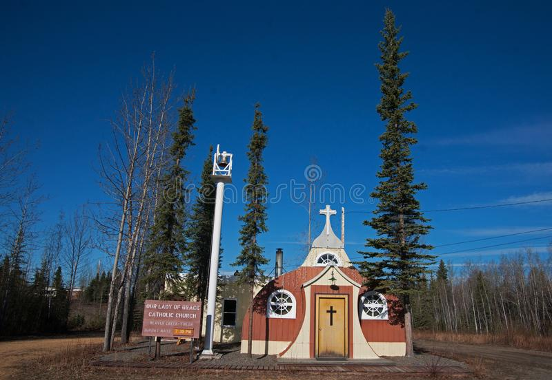 Vintage Catholic Church Beaver Creek Canada. World War Two Vintage Quonset Hut Catholic Church on the Alaska Highway in Beaver Creek, Canada royalty free stock image