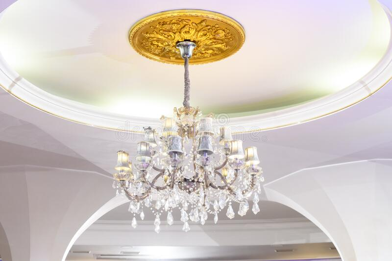 Vintage ceiling chandelier in white interior royalty free stock photo