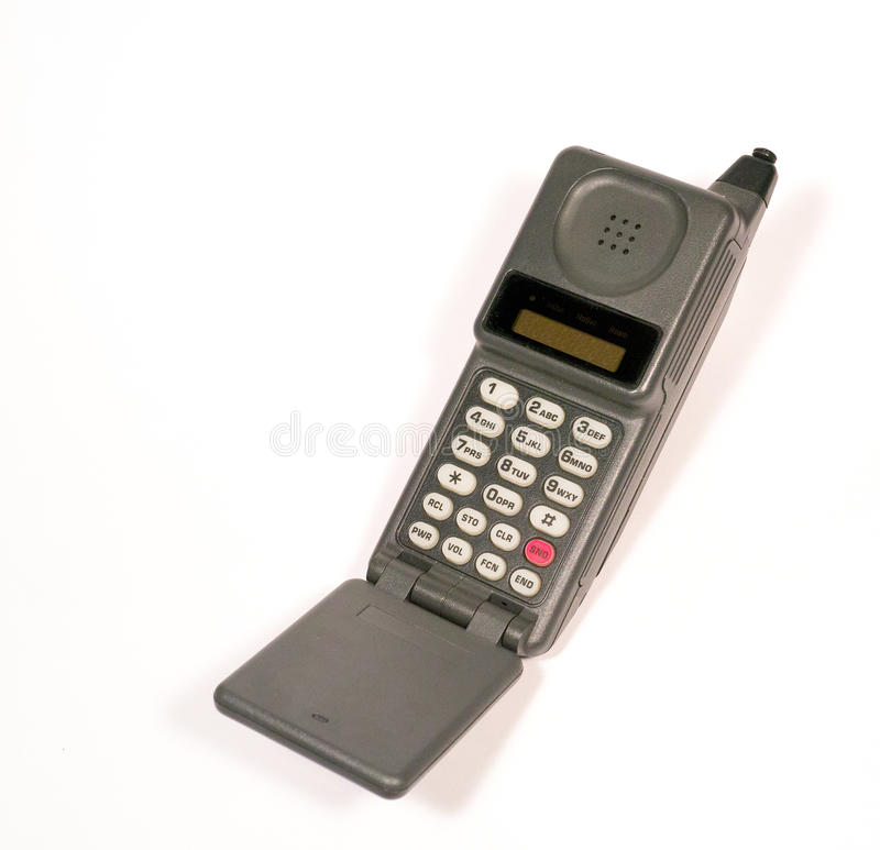 Vintage Cell Mobile Phone. An old, vintage mobile cell phone with flip down microphone royalty free stock images