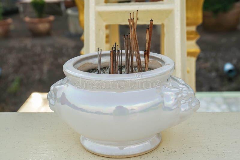 Vintage ceramic joss stick pot for holy stock image