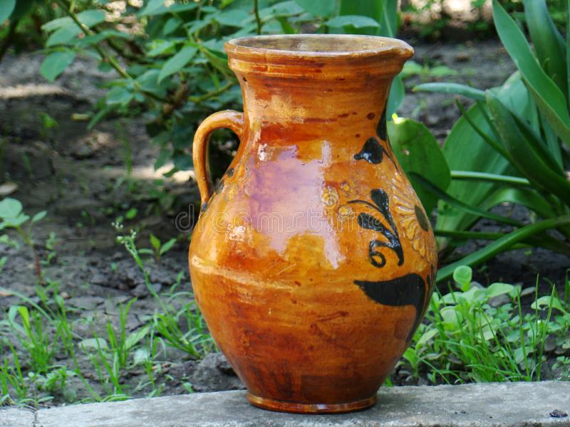 Vintage ceramic jug with painting. Photo of an old jug stock photo