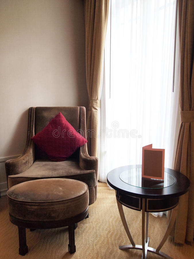 Vintage Chair. Vintage style chair in hotel room stock images