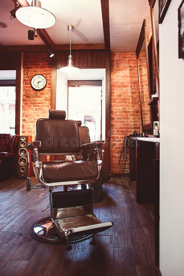 Vintage chair in barbershop stock image