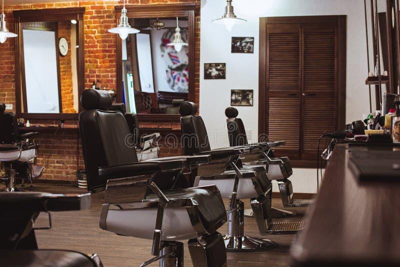 Vintage chairs in barbershop stock image