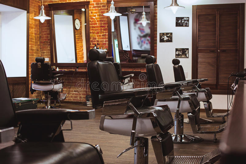 Vintage chairs in barbershop stock photo