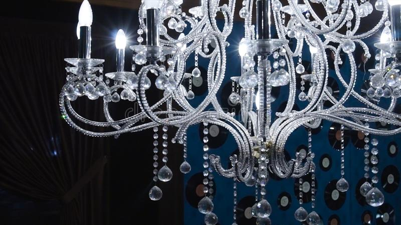Vintage chandelier. Clip. Close up on crystal of contemporary chandelier, is a branched ornamental light fixture stock photo