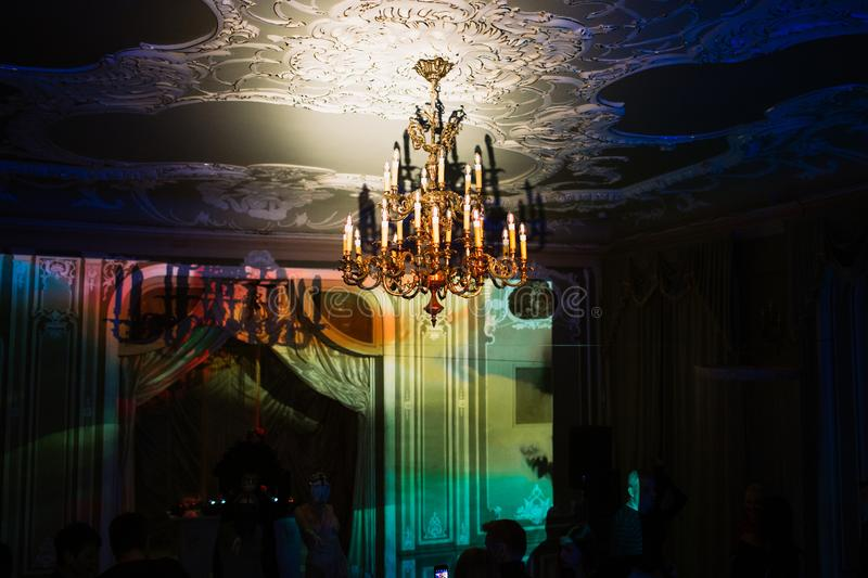 Vintage chandelier hanging from the ceiling in an old mansion royalty free stock image