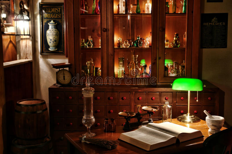 Vintage Chemist Desk in Antique Apothecary Shop royalty free stock photography