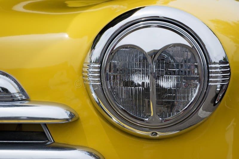 Vintage Chevy Automobile Headlight stock photography