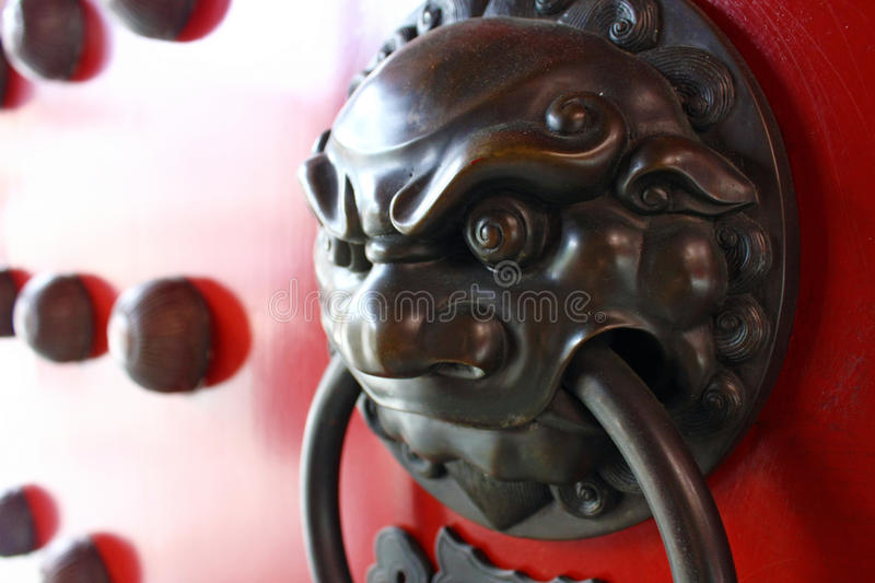 Vintage Chinese Fu Dog Lion. Asian door knockers are guardians at the gate and spell-casters. Indeed, ancient oriental cultures held that a door knocker's first royalty free stock photos