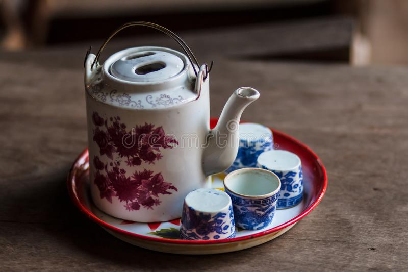 Vintage Chinese teapot and tea cups on wooden table. stock photography
