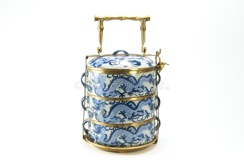 Vintage chinese tiffin. Vintage tiffin with chinese blue pattern on white back ground stock photos