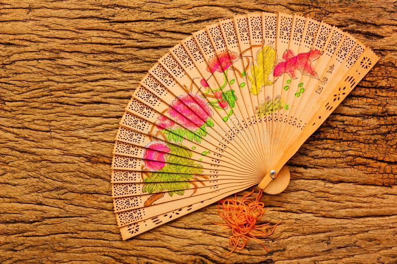 Vintage Chinese fan on retro wood background royalty free stock photo