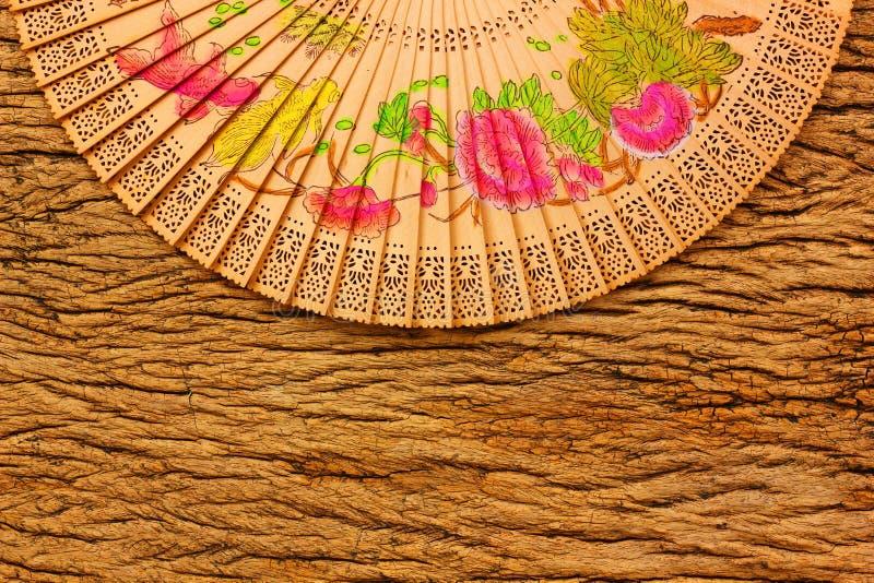 Chinese fan on retro wood background. Vintage Chinese fan on retro wood background royalty free stock photos