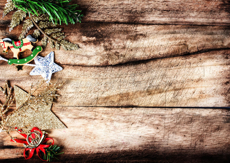 Vintage Christmas border with copy space, xmas decoration ans br. Anch of fir tree on old wooden background royalty free stock image