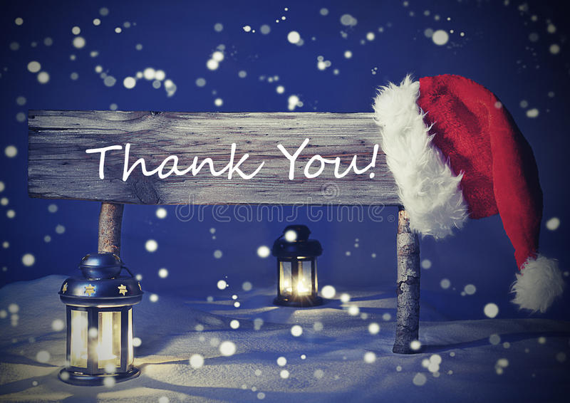Vintage Christmas Card With Sign, Candlelight, Thank You. Vintage Wooden Christmas Sign And Santa Hat With White Snow. English Text Thank You For Seasons stock photography
