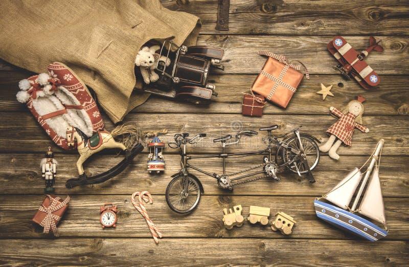 Vintage christmas decoration: old nostalgic children toys on woo stock photos