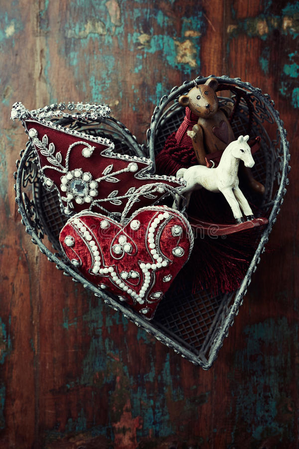 Vintage christmas decorations in a heart shaped basket. From above royalty free stock images