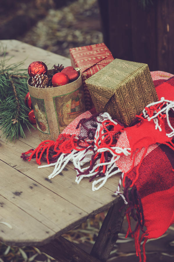 Vintage Christmas decorations at wooden country house. Preparing for New Year, wrapping gifts at home. Cozy rustic style royalty free stock image