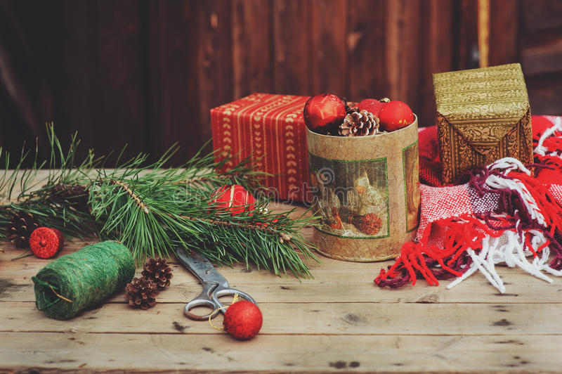 Vintage Christmas decorations at wooden country house. Preparing for New Year, wrapping gifts at home. Cozy rustic style royalty free stock photography