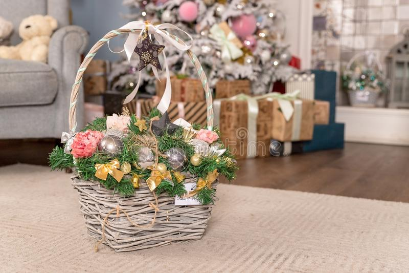 Vintage Christmas Gifts in Magic Composition with Basket. colorful balls, Pine cones, Sweet Candy, fir branches, Walnuts. Vintage Christmas Gifts in Magic royalty free stock images