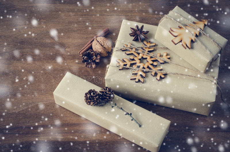 Vintage Christmas Kraft Boxes with Gifts Decorated in Rustic Style. Snow Falling Effect. stock photo