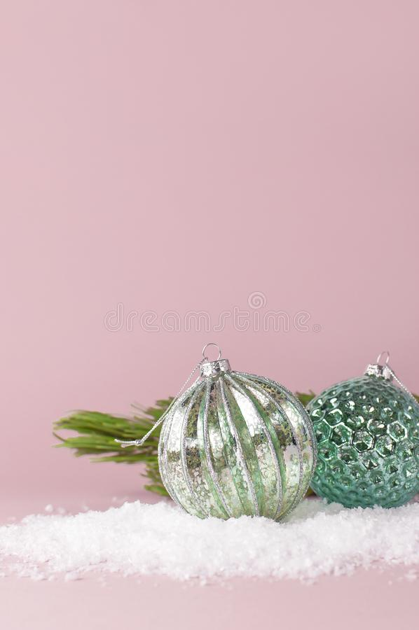 Vintage Christmas New Year balls in the snow and pine branches on pink background Flat Lay copy space. Holiday Baubles, beautiful royalty free stock photography