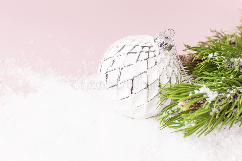 Vintage Christmas New Year balls in the snow and pine branches on pink background Flat Lay copy space. Holiday Baubles, beautiful stock image