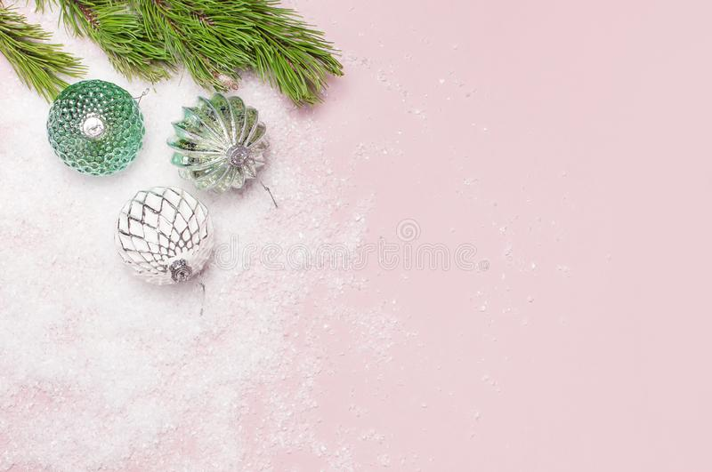 Vintage Christmas New Year balls in the snow and pine branches on pink background Flat Lay copy space. Holiday Baubles, beautiful royalty free stock photos