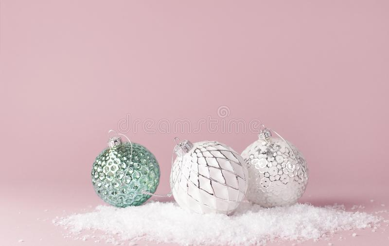 Vintage Christmas New Year balls in the snow on pink background Flat Lay copy space. Holiday Baubles, beautiful Decoration Festive stock photography