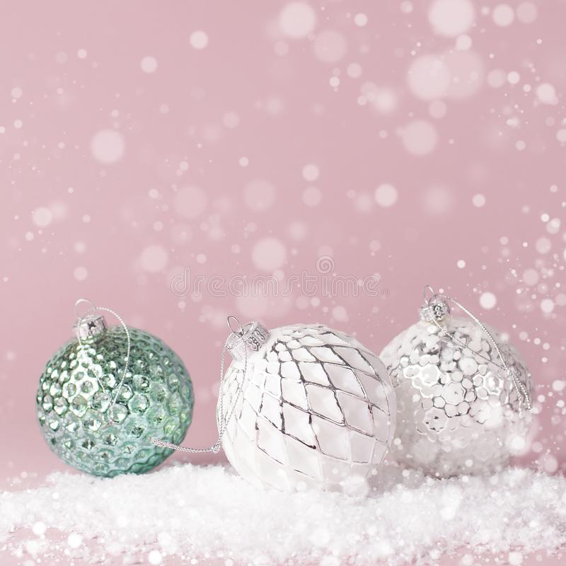 Vintage Christmas New Year balls in the snow on pink background Flat Lay copy space. Holiday Baubles, beautiful Decoration Festive royalty free stock image