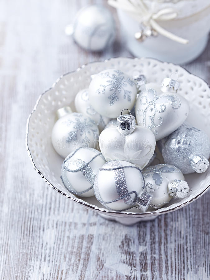 Vintage christmas ornaments in a white dish stock images