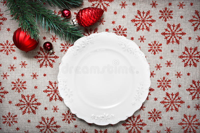 Vintage Christmas plate on holiday background with Red Christmas ornaments. Xmas card. Happy New Year. Space for text royalty free stock photo